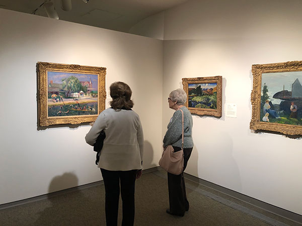 Picture of attendees touring Memorial Art Gallery