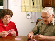 Picture of elderly couple playing cards.