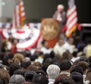Picture of candidate at town hall meeting.