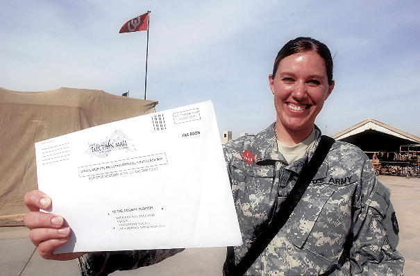 Picture of woman in military with absentee ballot