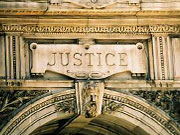 Picture of the word Justice on outside of building.