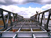 Picture of workers constructing the Irondequoit Bay Outlet Bridge.