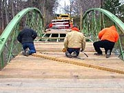 Picture of MCDOT crew laying planks.