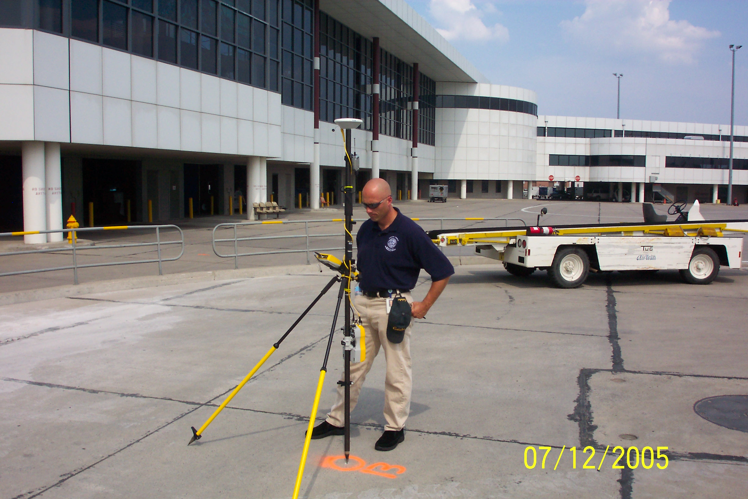 Worker collecting GPS data at the airport using a Trimble R8 high precision unit.