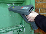 Picture of lead level in paint being determined by an XRF device.