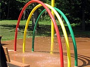 Picture of playground with standing water.