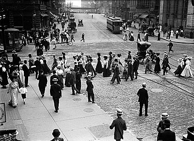 Old picture of people walking in downtown Rochester.