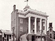 Historic picture of the first Courthouse (County Office Building).