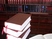 Picture of law library and open books.
