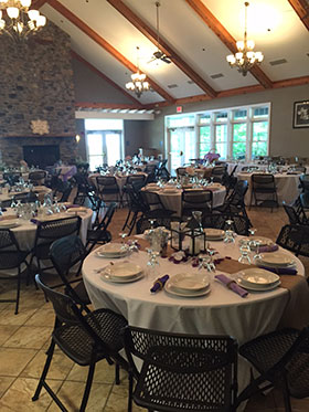 Tables set up for wedding at Durand Eastman Clubhouse