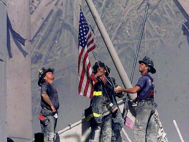 Picture of fire fighters with flag