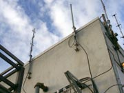 Picture of communications equipment on building.